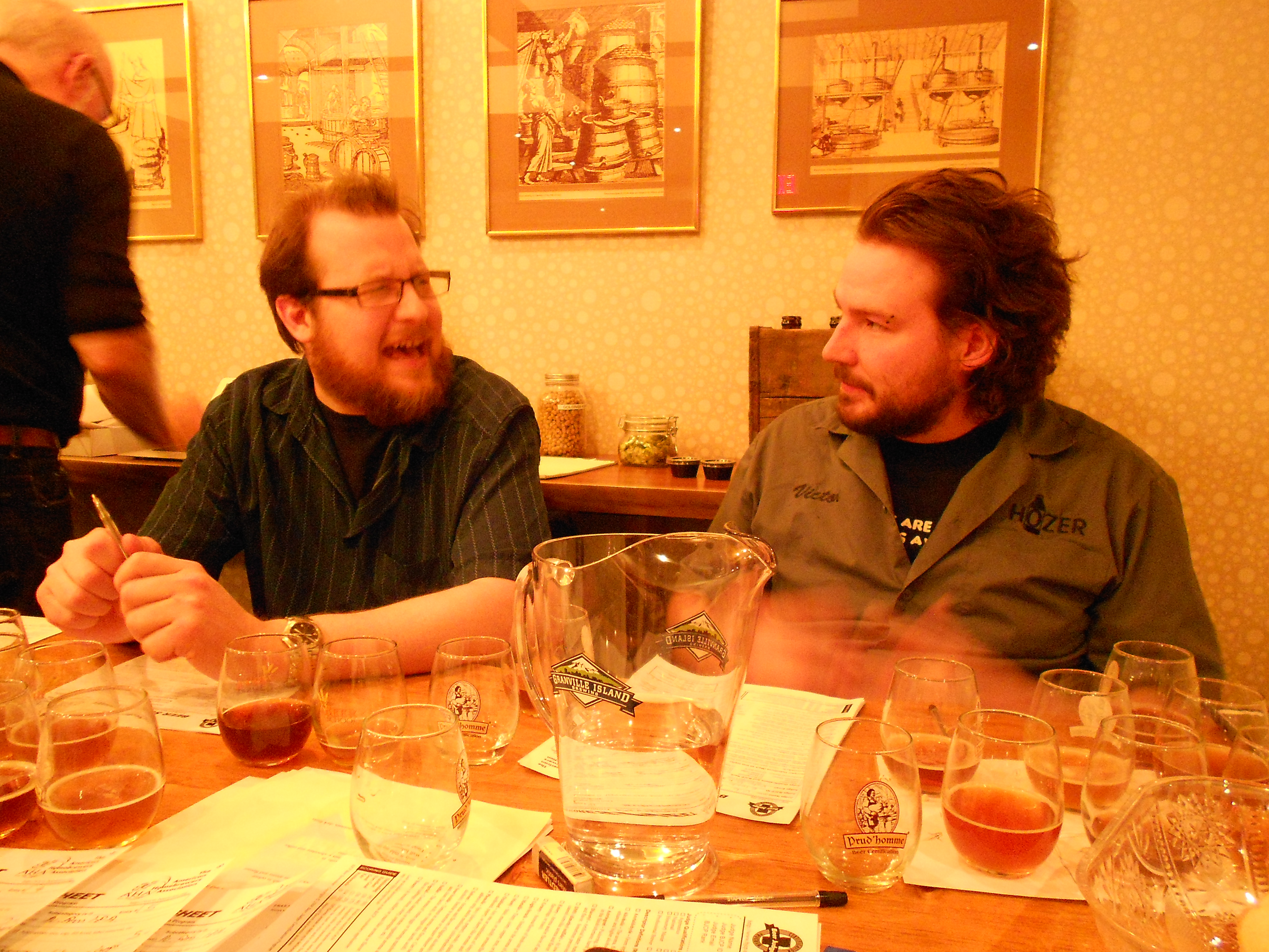 Brad Clifford (left) of Get Well Brewery and Victor North (right) of Three Brewers discussing a beer in the competition.