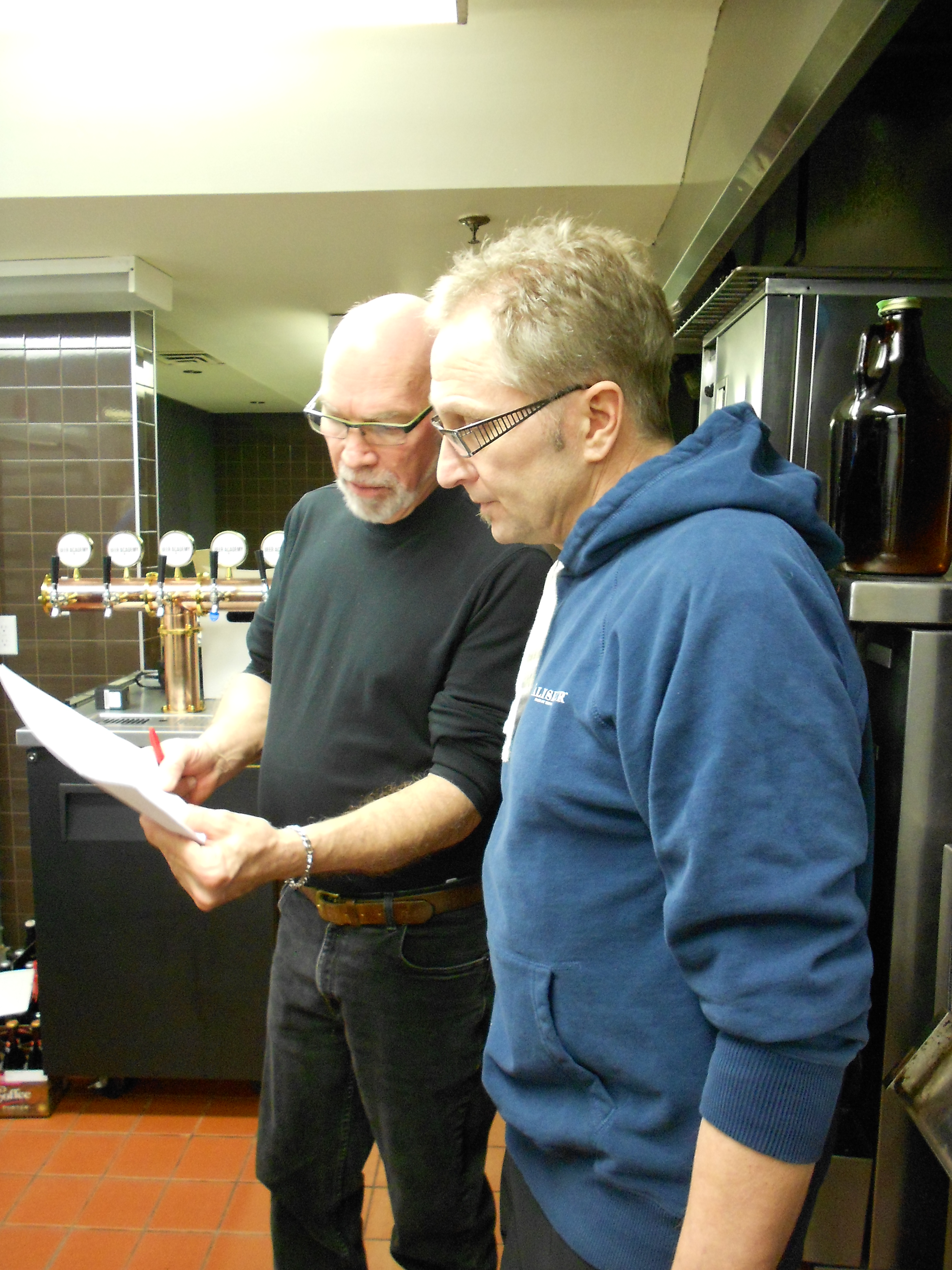 Paul Dickey (right) and Roger Mittag (left) discuss which table to send a flight of beers to.