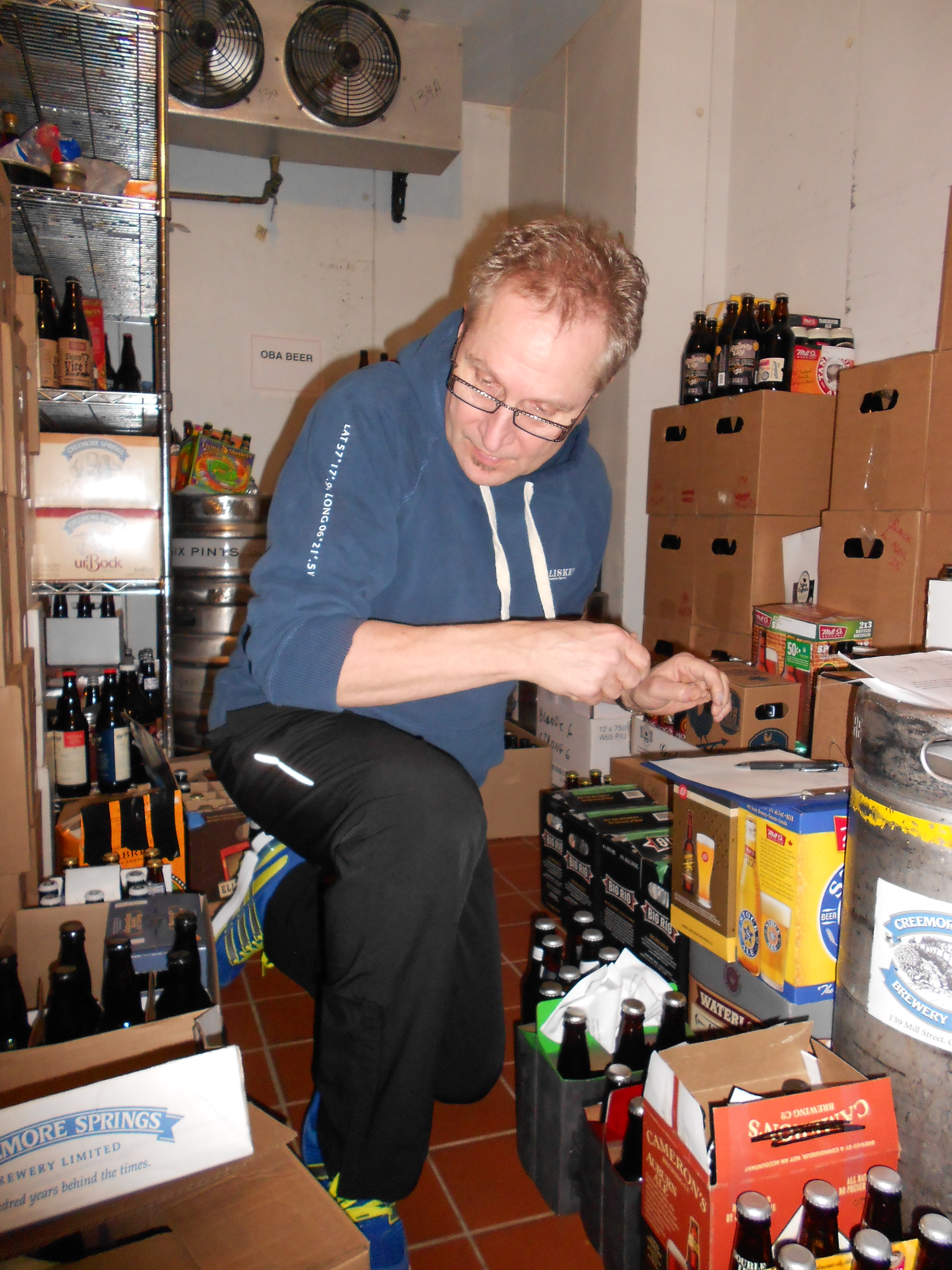 Roger Mittag, lead organizer of the Ontario Brewing Awards, sorting through beer submissions for the beer tastings.
